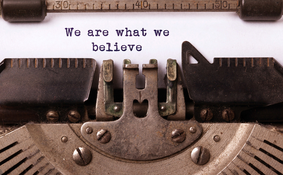 Vintage inscription made by old typewriter, we are what we believe