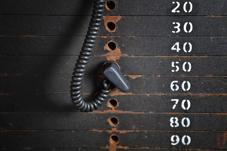 Old rusty weight stack in a gym.